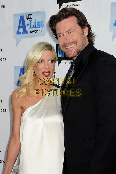 "TORI SPELLING & DEAN McDERMOTT.Bravo's 2nd Annual ""The A-List Awards"" held at The Orpheum Theatre, Los Angeles, CA, USA..April 5th, 2009.half length mini dress white silk satin black gold stubble facial hair jacket married husband wife red lipstick .CAP/ADM/BP.©Byron Purvis/AdMedia/Capital Pictures."