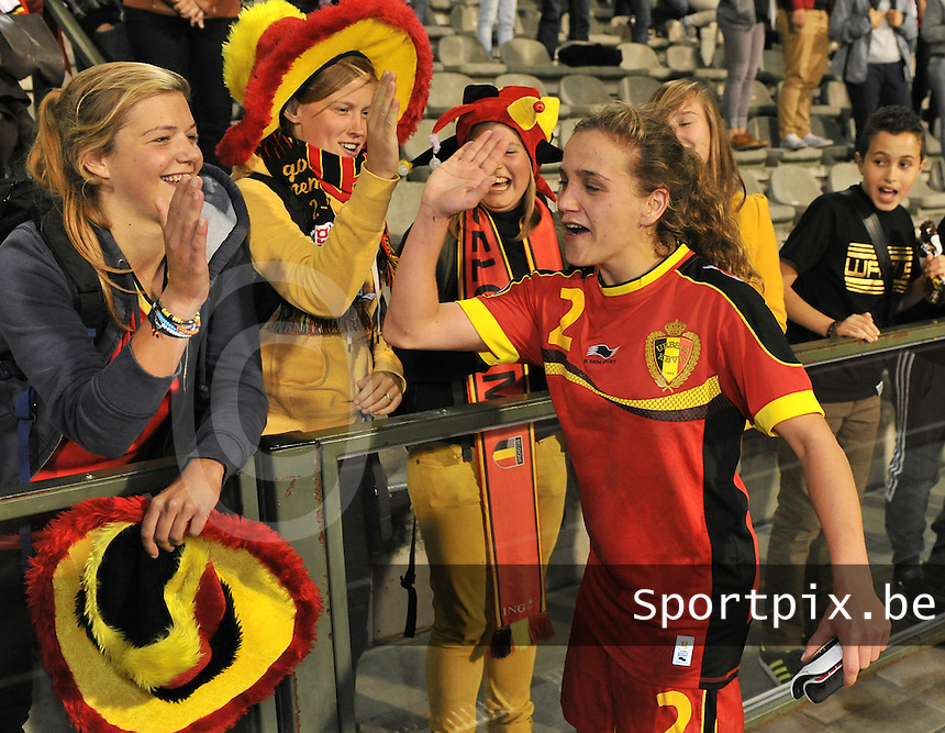 20130921 - BRUSSELS , BELGIUM : Belgian Davina Philtjens pictured celebrating with the fans / Supporters after the female soccer match between Belgium and Albania , on the first matchday in group 5 of the UEFA qualifying round to the FIFA Women World Cup in Canada 2015 at the Koning Boudewijn Stadion , Brussels . Saturday 21th September 2013. PHOTO DAVID CATRY