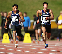 Auckland's Isaac Junior Tatoa and Tama Toki compete in the men's under-19 100m final during the National athletics championships at Newtown Park, Wellington, New Zealand on Friday, 27 March 2009. Photo: Dave Lintott / lintottphoto.co.nz