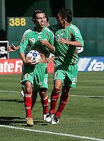 Luis Miguel Noriega tucks the ball under his shirt after scoring the first goal for Mexico. Mexico defeated Nicaragua 2-0 during the First Round of the 2009 CONCACAF Gold Cup at the Oakland, Coliseum in Oakland, California on July 5, 2009.