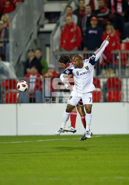 28 September 2010: Real Salt Lake midfielder Andy Williams #77 and Toronto FC defender Nick Garcia #4 in action during a CONCACAF Champions League game between Real Salt Lake and Toronto FC at BMO Field in Toronto...