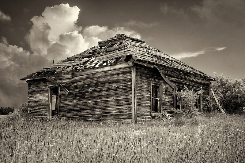 Abandoned pioneer cabin and thunderstorm clouds. Flora, Oregon