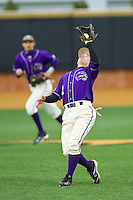 Western Carolina Catamounts second baseman Bradley Strong (1) catches a fly ball in shallow right field against the Wake Forest Demon Deacons at Wake Forest Baseball Park on March 26, 2013 in Winston-Salem, North Carolina.  The Demon Deacons defeated the Catamounts 3-1.  (Brian Westerholt/Four Seam Images)