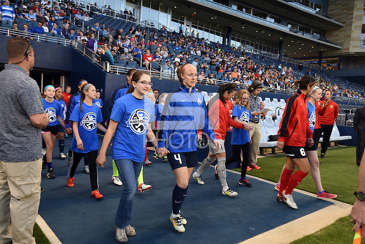 Kansas City, Kansas - Saturday April 16, 2016: FC Kansas City defender Becky Sauerbrunn (4) walks to the pitch before the game against Western New York Flash at Children's Mercy Park. Western New York won 1-0.