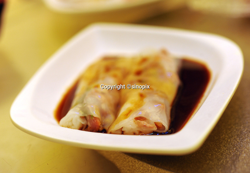 A vermicelli roll stuffed with barbecue pork that costs 15 HK$ in Tim Ho Wan the cheapest Michelin starred restaurant in the world, Hong Kong..17-Jul-11..Photo by Richard Jones...