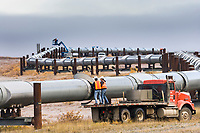 Alyeska workers do service maintenance on the trans Alaska oil pipeline in Atigun Canyon, Brooks Range, Arctic, Alaska.