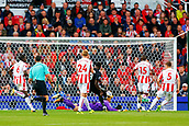 9th September 2017, bet365 Stadium, Stoke-on-Trent, England; EPL Premier League football, Stoke City versus Manchester United; Romelu Lukaku of Manchester United scores his teams second goal as he lifts the ball over Jack Butland of Stoke City