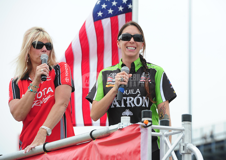 Jun. 29, 2012; Joliet, IL, USA: NHRA funny car driver Alexis DeJoria (right) during qualifying for the Route 66 Nationals at Route 66 Raceway. Mandatory Credit: Mark J. Rebilas-