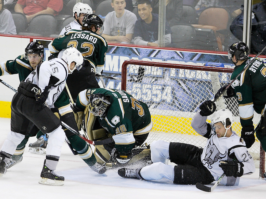 AMERICAN HOCKEY LEAGUE -- San Antonio's Nate DiCasmirro (15) tries to sneak a shot past Iowa goalie Philippe Sauve (30), while teammate Chris Durno (25) is taken down by Stars player Trevor Byrne (3), during the game between the San Antonio Rampage and the Iowa Stars, Dec. 8, 2007, at the AT&T Center, San Antonio, Texas. Iowa won 3 - 2 in overtime. (Darren Abate/pressphotointl.com)