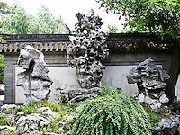 Stone / rock sculpture transforms into a fountain when it rains.  Yu Gardens, a peaceful place to escape the bustle of Shanghai.  Full of visitors, still very calming.  Details in the buildings, doors and stone sculptures.  Helps get your Ying and Yang in balance.