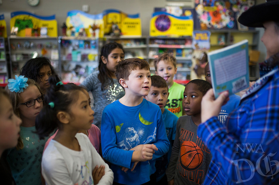 NWA Democrat-Gazette/CHARLIE KAIJO Joseph Warren, 8 and his classmates listen to an orientation before picking out books on Monday, October 23, 2017 at the Scholastic Book Fair at the Osage Creek Elementary and Creekside Middle School library in Bentonville. The fair continues until Friday, and proceeds go to benefit the schools' library. The library is also collecting donations to buy books for the Benton County Sunshine School's library.