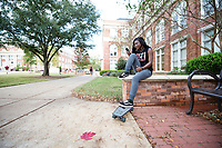 Student with skateboard near McCain.<br />  (photo by Megan Bean / &copy; Mississippi State University)