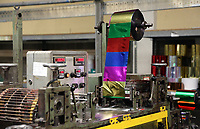 Pictured: One of the machines that makes tinsel on the factory floor. Thursday 16 November 2017<br /> Re: Festive company which manufactures tinsel in Cwmbran, Wales, UK.