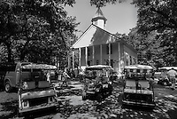 Golf carts from private communities on Daufuskie Island surround the First Union African Baptist. Traditionally a Gullah church, it is now also used by residents of the private gated communities and visitors to the island. The church, now a historical landmark, began in 1879 when John Stoddard divided his Mary Field plantation into lots and sold 12 acres to former slaves for the purpose of building a church and cemetery. The original church building burned in 1884 and was rebuilt in 1885.