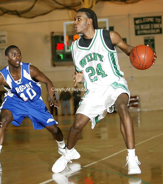 WATERBURY, CT 01/08/08-010808BZ08- Wilby's Jeremi Johnson (24) goes against Crosby's Gary Madison (40) during their game at Wilby High School Tuesday night.<br /> Jamison C. Bazinet Republican-American