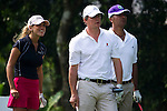 HAIKOU, CHINA - OCTOBER 30:  Spanish golfer Belen Mozo (L), Hugh Grant (C) of Great Britain and Ruud Gullit of the Netherlands look on at the 10th tee during day four of the Mission Hills Start Trophy tournament at Mission Hills Resort on October 30, 2010 in Haikou, China. The Mission Hills Star Trophy is Asia's leading leisure liflestyle event and features Hollywood celebrities and international golf stars. Photo by Victor Fraile / The Power of Sport Images