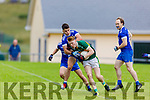 Knocknagoshel's John Bell breaks from the tackle from  James Crean of Annascaul in the Kerry Junior Club Championship round 1 game on Sunday.