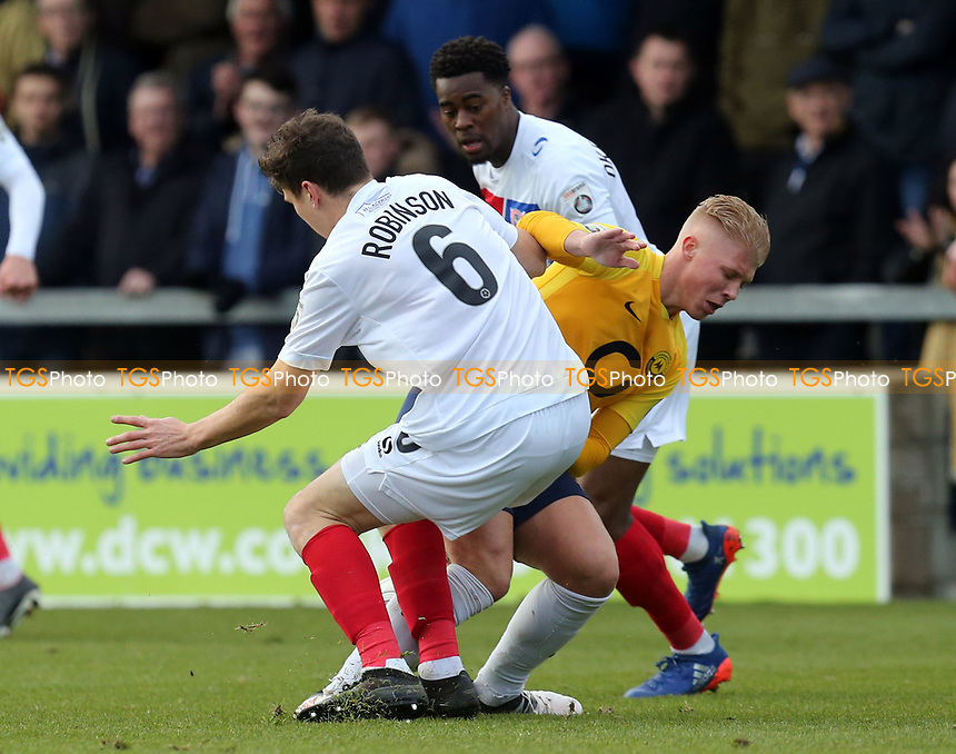 George Dowling of Torquay United and Matt Robinson of Dagenham  during Torquay United vs Dagenham & Redbridge, Vanarama National League Football at Plainmoor on 17th February 2018