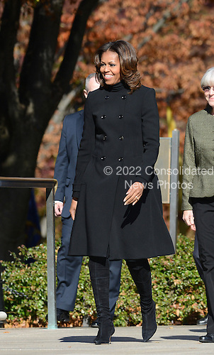 First Lady Michelle Obama arrives at a ceremony to honor veterans at the Tomb of the Unknowns at Arlington National Cemetery on November 11, 2013 in Arlington, Virginia.<br /> Credit: Olivier Douliery / Pool via CNP