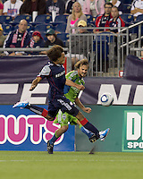 Seattle Sounders FC forward Roger Levesque (24) crosses the ball as New England Revolution defender Kevin Alston (30) closes. The New England Revolution defeated the Seattle Sounders FC, 3-1, at Gillette Stadium on September 4, 2010.