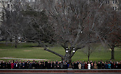 Spectators watch as a U.S. military honor guard team carries the flag draped casket of former U.S. President George H. W. Bush from the U.S. Capitol December 5, 2018 in Washington, DC. A funeral service will be held today for former U.S. President Bush at the Washington National Cathedral. President Bush will be buried at his final resting place at the George H.W. Bush Presidential Library at Texas A&M University in College Station, Texas. A WWII combat veteran, Bush served as a member of Congress from Texas, ambassador to the United Nations, director of the CIA, vice president and 41st president of the United States. <br /> Credit: Win McNamee / Pool via CNP