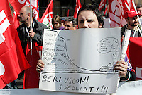 "Manifestazione nazionale della Cgil a Roma, 4 aprile 2009, contro le politiche economiche e sociali del governo..A demonstrator holds a sign reading ""Berlusconi wake up"" during a rally by the Italian General Confederation of Labour (CGIL) labour union in Rome, 4 april 2009, against Italian government's social and economic policies..UPDATE IMAGES PRESS/Riccardo De Luca"