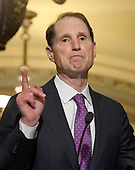United States Senator Ron Wyden (Democrat of Oregon) speaks to reporters outside the US Senate Chamber following the Democrats' weekly luncheon caucus in the US Capitol in Washington, DC on Tuesday, September 19, 2017.  The Democratic leadership is advocating against the passage of the Graham-Cassidy Act that would replace parts of the Affordable Care Act (also known as ObamaCare) with block grants for the individual states.<br /> Credit: Ron Sachs / CNP