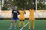 09 September 2016: The members of Canada's Bronze Medal winning Women's Soccer team from the 2016 Rio Olympic Games were recognized before the game. From left: Duke's Rebecca Quinn (CAN), and West Virginia's Ashley Lawrence (CAN) (9) and Kadeisha Buchanan (CAN) (88). The Duke University Blue Devils hosted the West Virginia University Mountaineers at Koskinen Stadium in Durham, North Carolina in a 2016 NCAA Division I Women's Soccer match. West Virginia won the match 3-1.