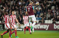 Marko Arnautovic of West Ham United heads in the first disallowed goal during the Premier League match between West Ham United and Stoke City at the Olympic Park, London, England on 16 April 2018. Photo by Andy Rowland.