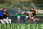 Dan Leary  Kilcummin is tackled by Eoin Brosnan Dr Crokes during their O'Donoghue cup SF in Lewis Rd on Saturday