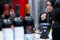 A woman drinks a French wine during the 41st International Food and Beverage Exhibition (FOODEX JAPAN 2016) on March 8, 2016, Chiba, Japan. 3,000 exhibitors from 78 nations are showcasing their products in Asia's largest food and beverage trade show held at Makuhari Messe. This year organisers expect 75,000 visitors during the four day show from March 8 to 11. (Photo by Rodrigo Reyes Marin/AFLO)