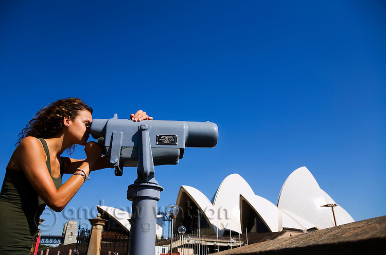 A woman looks out over Sydney harbour.  Sydney, New South Wales, AUSTRALIA.