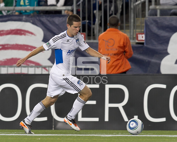 San Jose Earthquakes midfielder Sam Cronin (4) dribbles down the wing. In a Major League Soccer (MLS) match, the San Jose Earthquakes defeated the New England Revolution, 2-1, at Gillette Stadium on October 8, 2011.