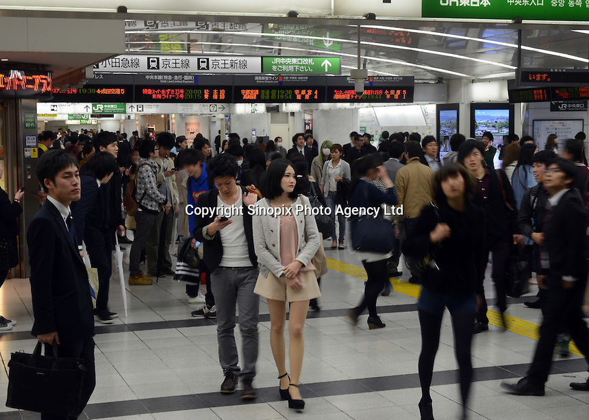 Passengers rush through the East Exit during evening rush hour, Shinjuku, Tokyo. With up to 4 million passengers passing through it every day, Shinjuku station, Tokyo, Japan, is the busiest train station in the world. The station was used by an average of 3.64 million people per day.  That's 1.3 billion a year.  Or a fifth of humanity. Shinjuku has 36 platforms, and connects 12 different subway and railway lines.  Morning rush hour is pandemonium with all trains 200% full. <br /> <br /> Photo by Richard jones / sinopix`