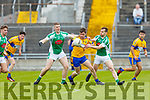 Jamie Lowham and Mike Griffin of Na Gaeil putting pressure on Mike Keane of St Senans in the Junior Premier Football Championship final on Sunday.