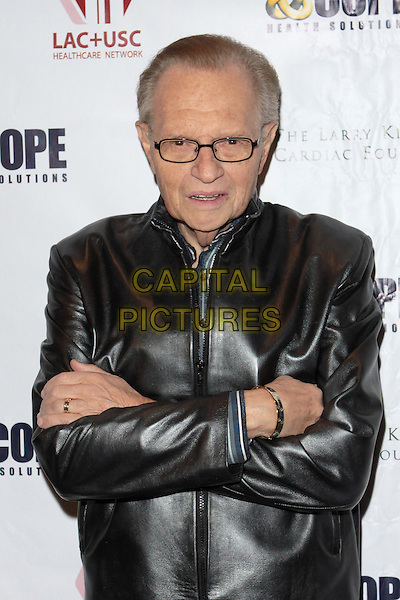LARRY KING.The Larry King Cardiac Foundation And Cope Health Solutions Fundraiser held at the BOA SteakHouse Restaurant, Beverly Hills, California, USA,.6th Novemder 2009.half length black leather jacket arms folded glasses crossed .CAP/ADM/TC.©T. Conrad/AdMedia/Capital Pictures.