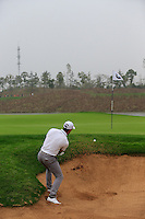 Romain Wattel (FRA) chips from a bunker at the 17th green during Saturay's Round 3 of the 2014 BMW Masters held at Lake Malaren, Shanghai, China. 1st November 2014.<br /> Picture: Eoin Clarke www.golffile.ie