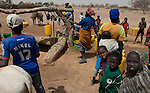 Kouré (Koure)-Niger, March 25, 2012 -- Villagers at a well drawing water up -- Photo © HorstWagner.eu