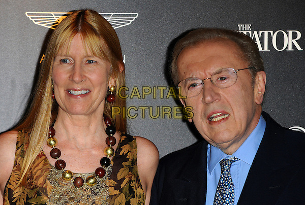 Lady Carina Frost & Sir David Frost.Quintessentially Awards held at One Marylebone - Arrivals, London, England..28th September 2011.headshot portrait black blue suit shirt brown beige green print pattern married husband wife glasses mouth open leaf leaves nature .CAP/CJ.©Chris Joseph/Capital Pictures.