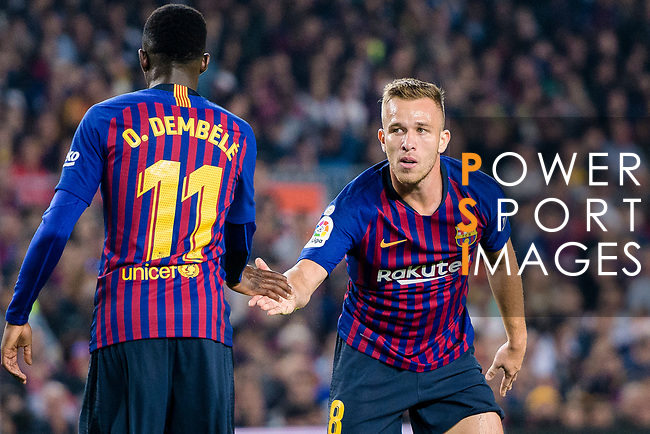 Ousmane Dembele of FC Barcelona (L) high five Arthur Melo of FC Barcelona (R) during the La Liga 2018-19 match between FC Barcelona and Sevilla FC at Camp Nou Stadium on October 20 2018 in Barcelona, Spain. Photo by Vicens Gimenez / Power Sport Images