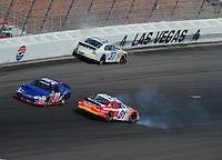 Mar 1, 2008; Las Vegas, NV, USA; Nascar Nationwide Series driver Larry Gunselman (91) drives between the crashing cars of D.J. Kennington (81) and Brad Baker (37) during the Sams Town 300 at the Las Vegas Motor Speedway. Mandatory Credit: Mark J. Rebilas-US PRESSWIRE