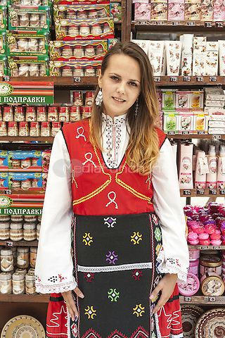 Young female shop assistant wearing traditional Bulgarian costume, Nessebar, Bulgaria  June 2015.<br /> CAP/MEL<br /> &copy;MEL/Capital Pictures /MediaPunch ***NORTH AND SOUTH AMERICA ONLY***