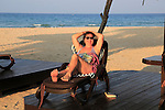 Woman relaxing in sun lounger Nilavelli beach, near Trincomalee, Eastern province, Sri Lanka, Asia