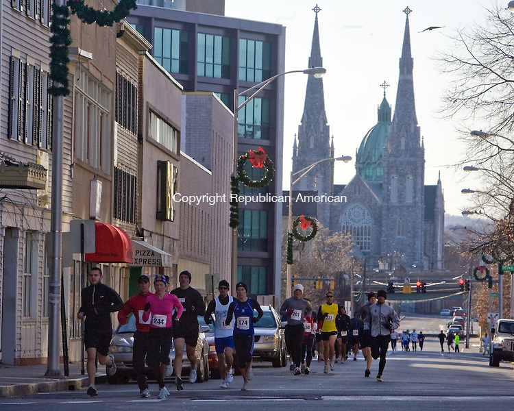 WATERBURY, CT - 23 NOVEMBER 2008 -112308JT01-<br /> The Shrine of Saint Anne for Mothers is seen in the background as runners make their way up South Main Street in downtown Waterbury for the annual Fischang-Cicchetti Memorial Five-Mile Run on Sunday. The first male finisher was 38-year-old Joseph Ekuom of the Bronx, NY, with a time of 24:52. The first female finisher was Brett Romano Ely of Natick, Mass. with a time of 29:02.<br /> Josalee Thrift / Republican-American