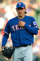 "Texas Rangers starting pitcher Derek Holland #45 during the MLB exhibition baseball game against the ""AAA"" Round Rock Express on April 2, 2012 at the Dell Diamond in Round Rock, Texas. The Rangers out-slugged the Express 10-8. (Andrew Woolley / Four Seam Images)."