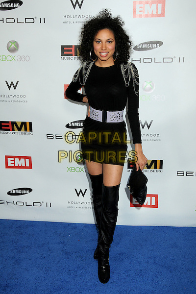 JURNEE SMOLLETT .EMI Post Grammy Party 2010 held at the W Hollywood Hotel, Hollywood, California, USA, 31st January 2010..full length black dress chains shoulder pads epaulettes waist belt clutch bag otk over the knee boots  silver hand on hip grammys .CAP/ADM/BP.©Byron Purvis/Admedia/Capital Pictures