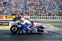 Jul. 1, 2012; Joliet, IL, USA: NHRA pro stock motorcycle rider Hector Arana Jr (near lane) races alongside Mike Berry during the Route 66 Nationals at Route 66 Raceway. Mandatory Credit: Mark J. Rebilas-
