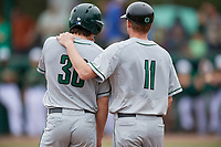 Dartmouth Big Green Trevor Johnson (36) and assistant coach Jonathan Anderson (11) during a game against the USF Bulls on March 17, 2019 at USF Baseball Stadium in Tampa, Florida.  USF defeated Dartmouth 4-1.  (Mike Janes/Four Seam Images)
