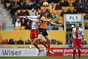 Jimmy Smith of Stevenage and Bjorn Sigurdarson of Wolves contest a header<br />  - Wolverhampton Wanderers v Stevenage - Sky Bet League One - Molineux, Wolverhampton - 2nd November 2013. <br /> © Kevin Coleman 2013