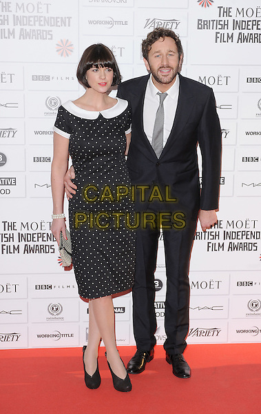 Dawn Porter and Chris O'Dowd .14th Moet British Independent Film Awards 2011, Old Billingsgate, Lower Thames Street, London, England, 4th December 2011.full length black polka dot dress collar suit couple beard facial hair .CAP/BEL.©Tom Belcher/Capital Pictures.